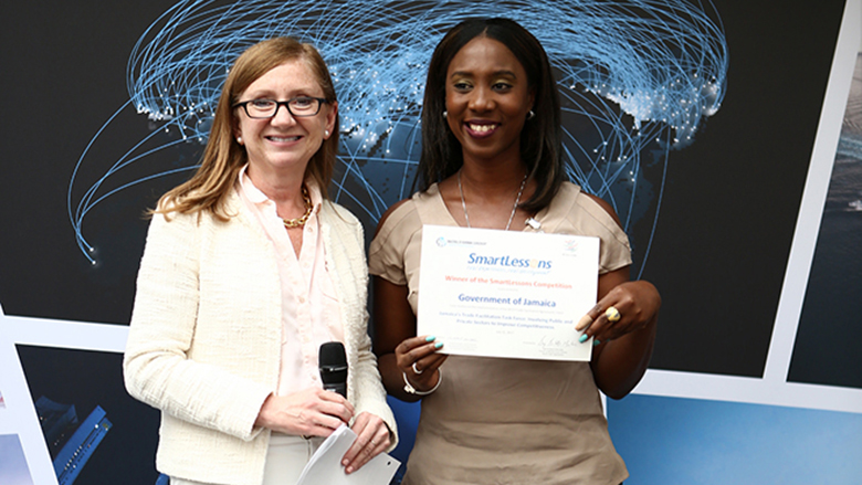 Kanika Tomlinson accepts an award for Jamaica's SmartLessons Trade Facilitation Case Study